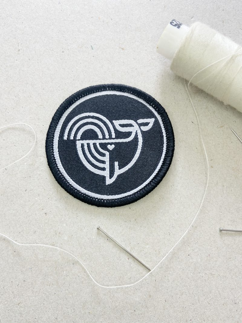 Embroidered Patch with Ecotribo Cleaning Seas icon